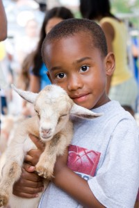 kemah black boy with goat